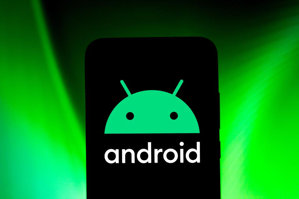 Android logo in green on black smartphone against a green background.