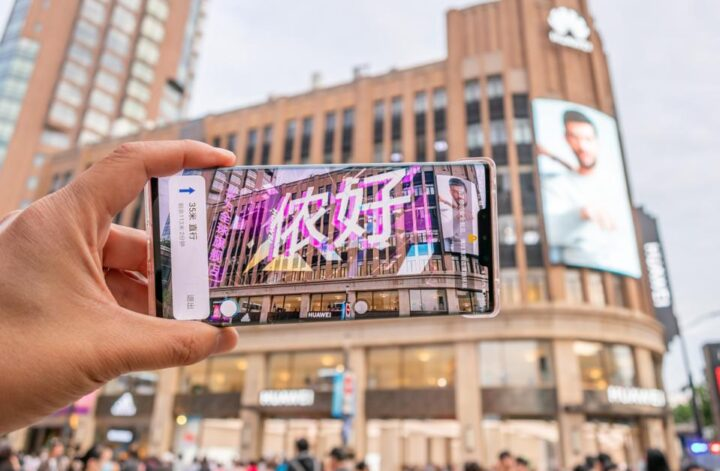 Tourist Visits The Bund With Huawei AR Map In Shanghai
